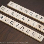 Block letters spelling out standard operating procedure